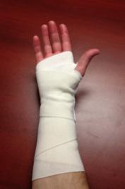 apply ace wrap(hand)